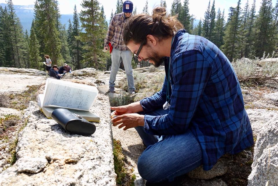 Student measuring an outcrop in the field