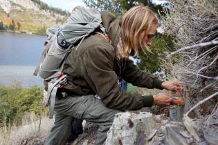 Student using a geologic compass